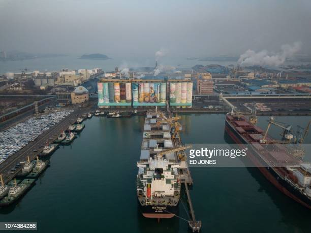 A mural listed by the Guinness World Records as the largest in the world is displayed on a grain silo in Incheon port west of Seoul on December 19...