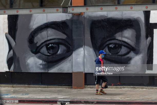 Mural of a black mans eyes is seen on a downtown building as people continue to protest the killing of George Floyd despite the dangers of the...