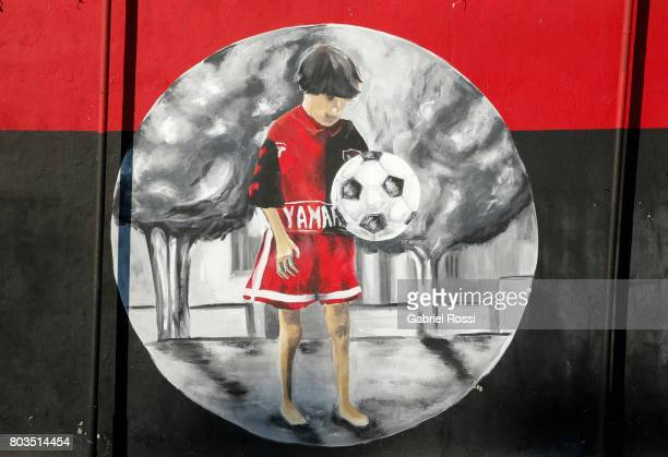 A mural of a young Lionel Messi is seen at Newell's Old Boys' Malvinas Sports Complex for Junior Divisions ahead of Lionel Messi and Antonela...