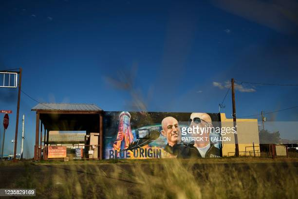 Mural of billionaire Amazon founder Jeff Bezos and his brother Mark Bezos with a Blue Origin rocket in Van Horn, Texas on October 11, 2021. - Blue...