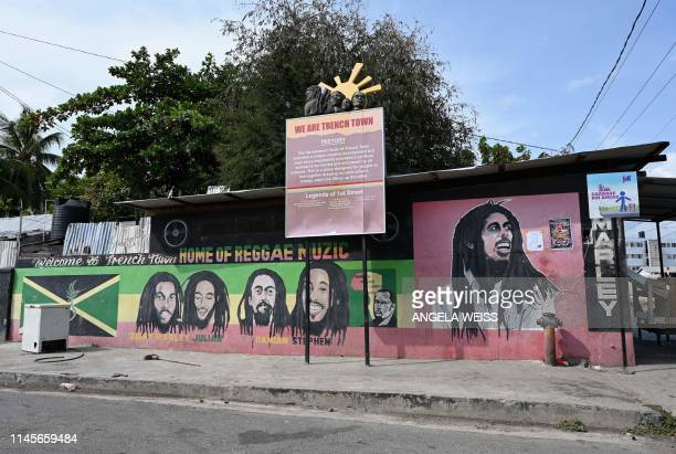 A mural of Bob Marley and his sons Ziggy Julian Damian and Stephen adorns the Trench Town neighborhood of Kingston Jamaica on May 18 2019 In the...