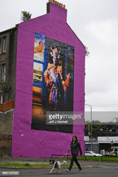 A mural of comedian Billy Connolly displayed on a gable wall in the Gallowgate on June 12 2017 in Glasgow Scotland Three murals based on original...