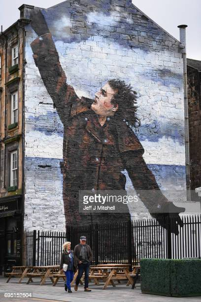 A mural of comedian Billy Connolly displayed on a gable wall in the Dixon Street on June 12 2017 in Glasgow Scotland Three murals based on original...