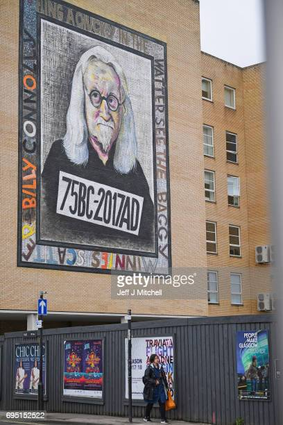 A mural of comedian Billy Connolly displayed on a gable wall in the Osborne Street on June 12 2017 in Glasgow Scotland Three murals based on original...