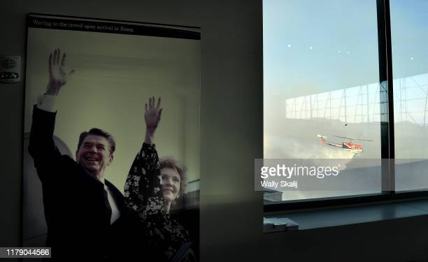 A mural of former US President Ronald Reagan and First Lady Nancy Reagan hangs on display at the Reagan Presidential Library as an LA City Fire...