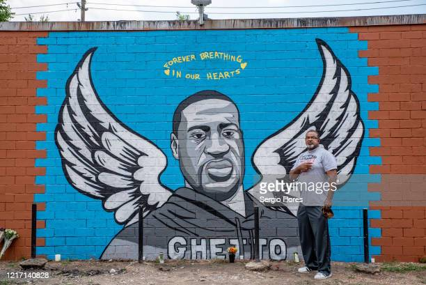 A mural of George Floyd is shown painted on the side of Scott Food Mart in the Third Ward before a march in his honor on June 2 2020 in Houston Texas...