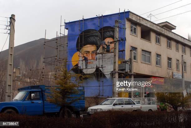 A mural of Iran's supreme leader Ayatollah Ali Khamenei and the founder of the Islamic Republic Ayatollah Khomeini painted on a wall in Fasham Iran...