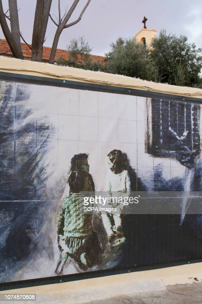 Mural of kids seen in Robert Capa Photographer square. In 1936 Robert Capa took an iconic photography of a building in Entrevías quarter, at...