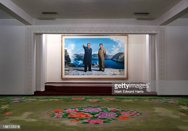 A mural of Kim Il Sung and Kim Jong Il at the Be Gae Bong Hotel near Mt Beaktu