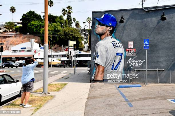 Mural of Los Angeles Dodgers pitcher Joe Kelly appears on wall at Floyd's 99 Barbershop in the Silverlake area on September 09, 2020 in Los Angeles,...