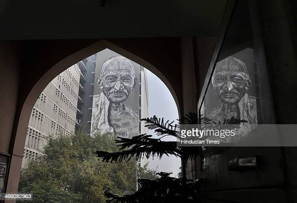 A mural of Mahatma Gandhi being painted on the walls of the Delhi Police Headquarters building which was unveiled by Lieutenant Governor of Delhi...