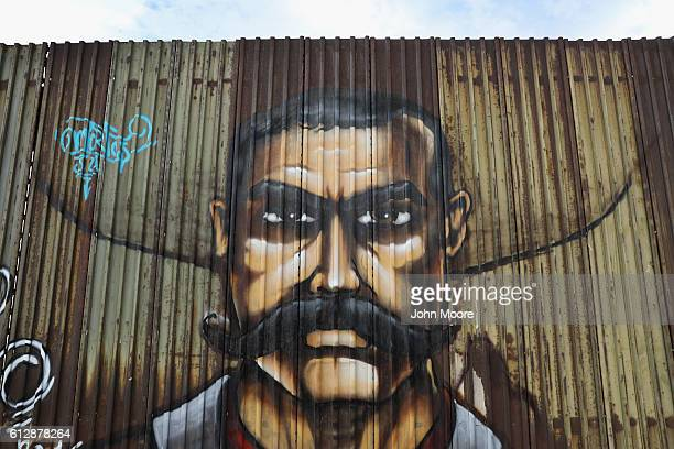 A mural of Mexican revolutionary hero Emiliano Zapata adorns the USMexico border fence on September 26 2016 in Mexicali Mexico The fence takes many...
