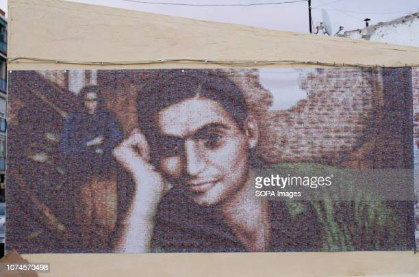 Mural of Robert Capa portrait seen in Robert Capa Photographer square. In 1936 Robert Capa took an iconic photography of a building in Entrevías...