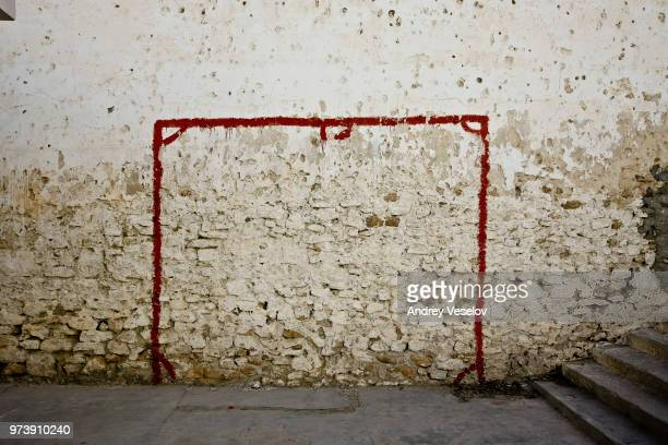 mural of soccer goal on wall, tunisia - bad condition stock photos and pictures