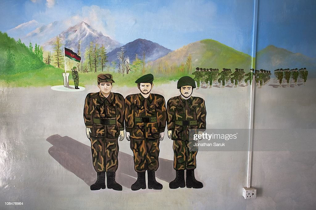 A mural of soldiers of the Afghanistan National Army inside a building at the Kabul Military Training Center March 19, 2009 in Kabul, Afghanistan. Approximately 25,000 soldiers a year graduate from the center located on the outskirts of Kabul. Increasing the number of Afghan soldiers is a major goal of coalition forces in Afghanistan.