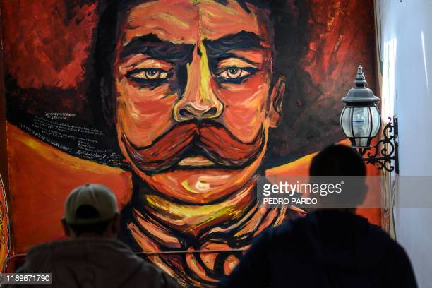 A mural of the Mexican revolutionary hero Emiliano Zapata is seen at the Greater Council in Cheran Michoacan state Mexico on December 10 2019 Located...