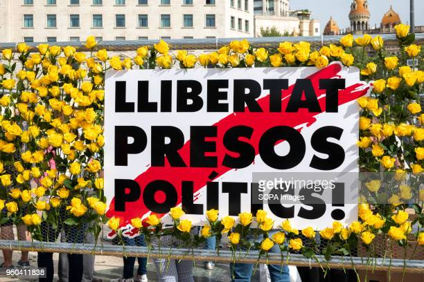 Mural of the yellow roses to remember the Catalan political prisoners still in preventive prison Catalunya celebrates the 'Day of Sant Jordi' the day...