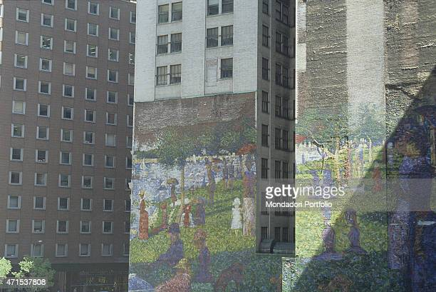 'A mural on a building in New York The subject of the mural is the painting A Sunday Afternoon on the Island of La Grande Jatte by the French painter...