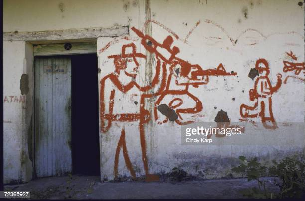 FMLN mural on on wall in town ravaged by civil war