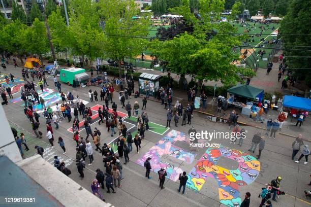 A mural on Pine Street spelling BLACK LIVES MATTER is painted along a block in an area dubbed the Capitol Hill Autonomous Zone on June 12 2020 in...