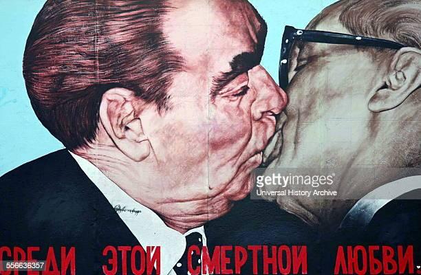 Mural on the Berlin Wall by Russian artist Dimitry Vrubel showing Soviet leader leonid Brezhnev kissing East German leader Honecker