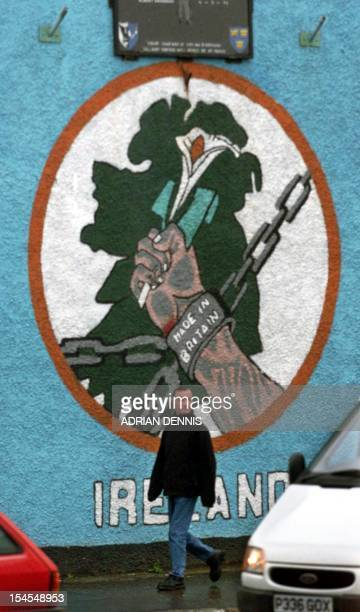 A mural on the side of a house near the Falls Road a predominantly Catholic area in Belfast 01 December 1999 Northern Ireland is granted devolved...