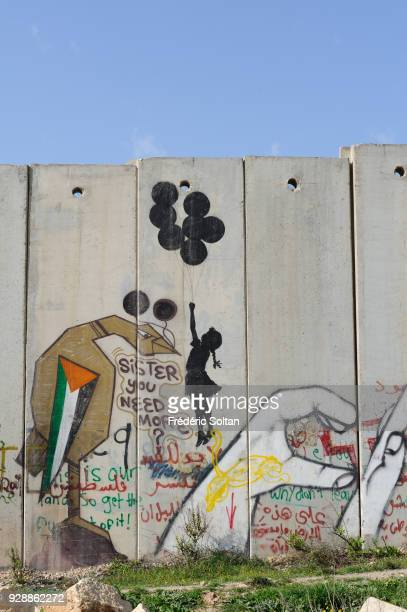 Mural on wall at Qalandia Checkpoint Political and social mural painting and graffitis on the Israeli West Bank barrier at the Qalandia checkpoint...