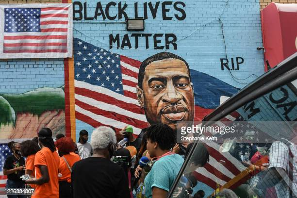 Mural painted by artist Kenny Altidor depicting George Floyd is unveiled on a sidewall of CTown Supermarket on July 13, 2020 in the Brooklyn borough...