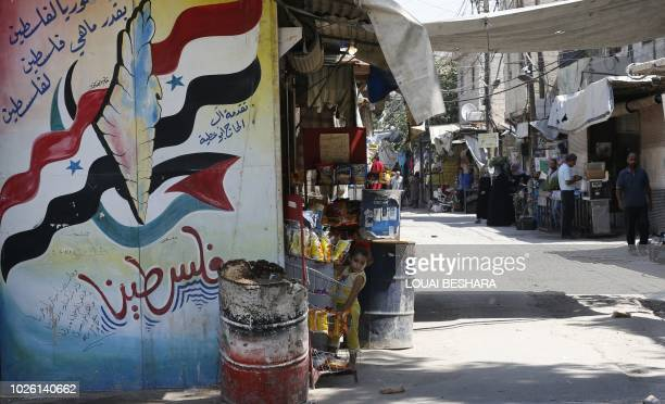 A mural painting about Palestine covers a wall at the Jaramana Palestinian refugee camp in the Syrian capital Damascus on September 2 2018 The UN...