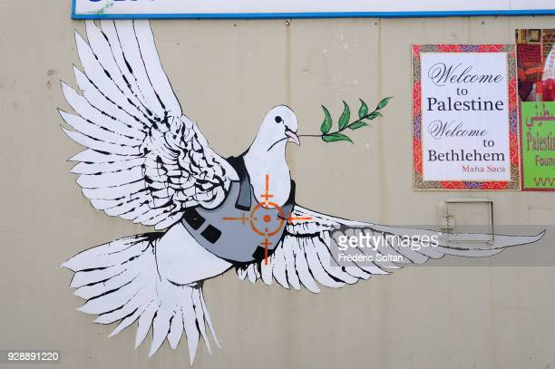 Mural painting and graffitis illustrating the dove of peace with a bulletproof vest in Bethlehem on April 14 2014 in Palestine