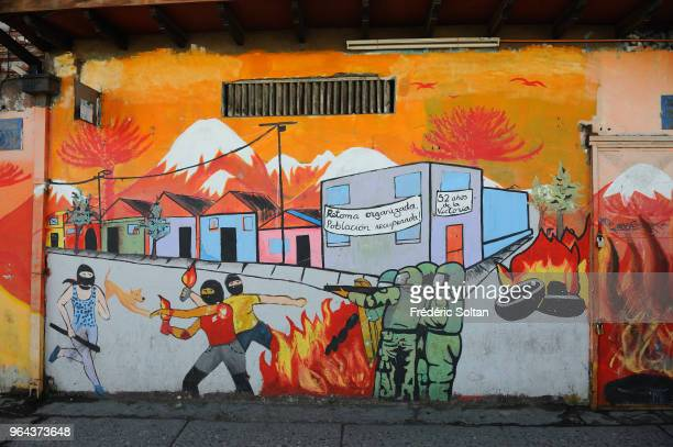 Mural painting and graffitis in the La Victoria area of Santiago de Chile In 50 years its inhabitants built an alternate city resisted to dictator...