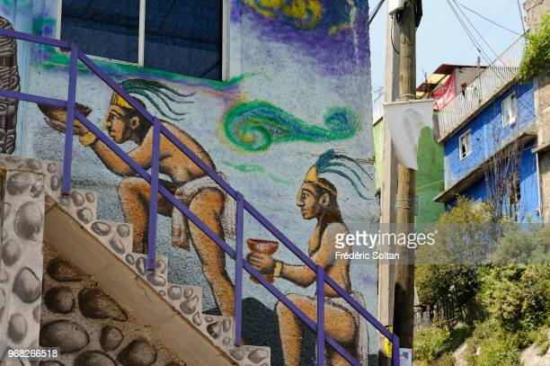 Mural painting and graffitis in the town of Mexico City Mural honouring the Aztec culture before the Spanish colonization Popular district of Mexico...
