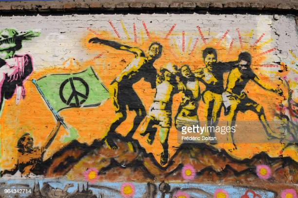 Mural painting and graffitis on the wall of peace in Santiago de Chile The 2km Wall of peace is the longest in the world Artists express their ideas...