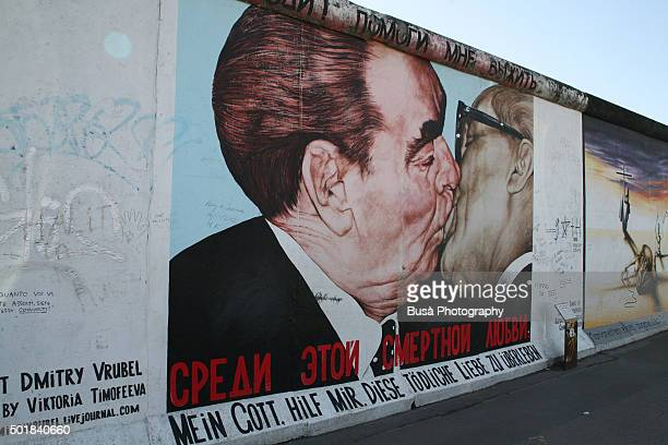 mural painting on the berlin wall, east side gallery, district of friedrichshain, berlin - germany - east stock pictures, royalty-free photos & images
