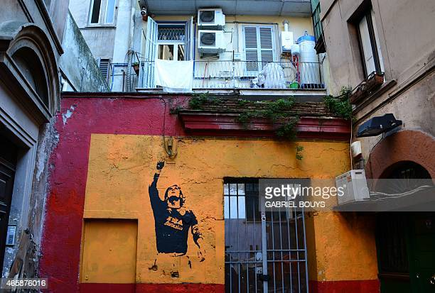 A mural painting showing AS Roma's captain Francesco Totti is seen in Rome on March 11 2015 AFP PHOTO / GABRIEL BOUYS