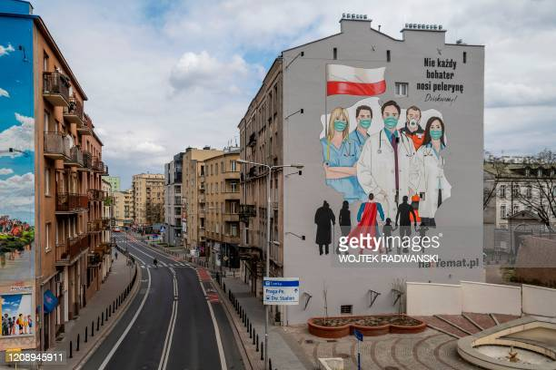 Mural paying tribute to the sacrifice of doctors, nurses and paramedics fighting with epidemic of the new coronavirus COVID-19, is seen in Warsaw...
