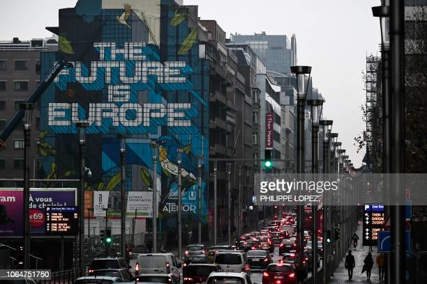 TOPSHOT A mural reading 'The future is Europe' is seen on a building outside the EU Headquarters in Brussels on November 24 2018 European leaders...