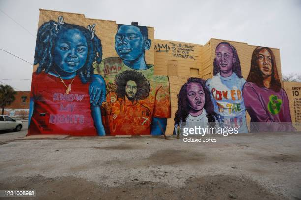 Mural showing Colin Kaepernick and people of color along representing his nonprofit Know Your Rights Camp, collaborated with Ben and Jerry's Ice...