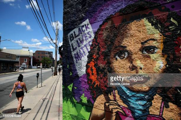 Mural supporting Black Lives Matter, painted by Jason Talbot, on Elm Street in Somerville, MA on June 20, 2020.
