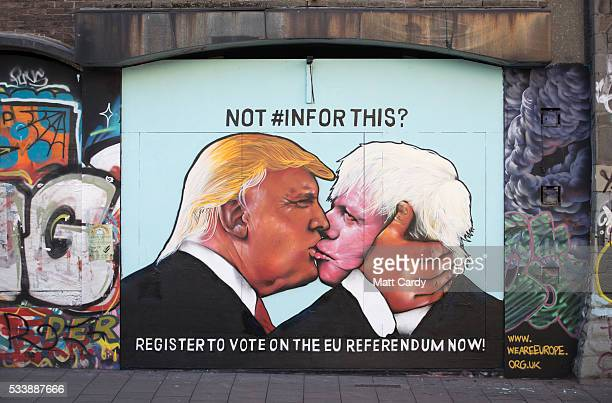 A mural that has been painted on a derelict building in Stokes Croft showing US presidential hopeful Donald Trump sharing a kiss with former London...