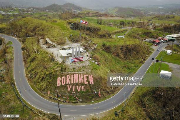 TOPSHOT A mural that reads in Spanish 'Boriken is alive' is seen a week after the passage of Hurricane Maria in Cayey Puerto Rico on September 27...