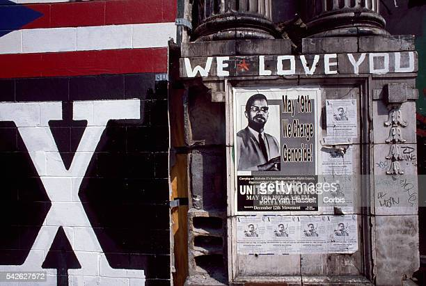 A mural to the memory of Malcolm X shares space with a poster for a political protest on the facade of the dilapidated Audubon Ballroom site of...