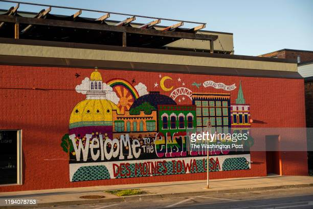 Mural welcomes visitors to Des Moines' East Village area on Monday, July 22, 2019 in Des Moines, Iowa.