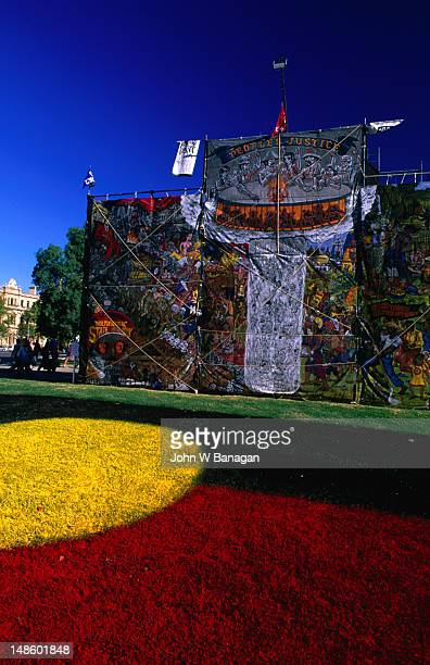 mural with aboriginal flag on grass at the adelaide festival. - adelaide festival stock pictures, royalty-free photos & images