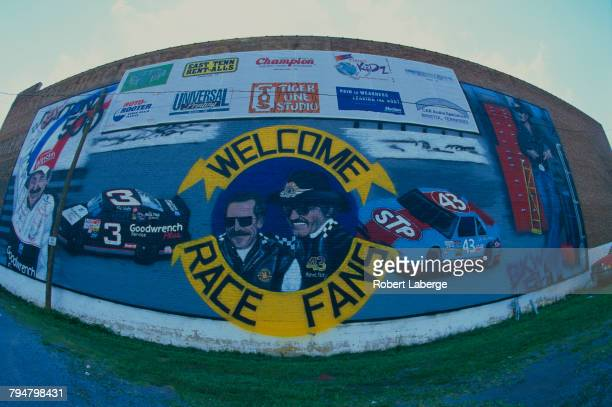 A mural with portraits of racing drivers Dale Earnhardt and Richard Petty surrounded by the text 'Welcome Race Fans' at the Bristol Motor Speedway in...