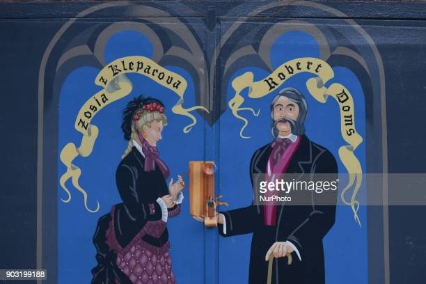 A mural with Zosia from Kreparov and Robert Doms near the entrance door to the cavernous cellar restaurant underneath Lvivske Brewery Robert Doms was...