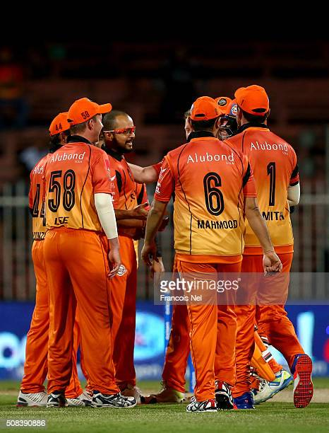 Murali Kartik of Virgo Super Kings celebrates with teammates after dismissing Brian Lara of Leo Lions during the Oxigen Masters Champions League...