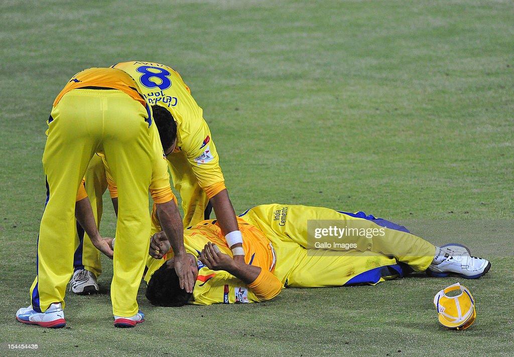 Murali Vijay of CSK lies injured after his catch to dismiss Kieron Pollard of Mumbai during the Karbonn Smart CLT20 match between Chennai Super Kings and Mumbai Indians at Bidvest Wanderers Stadium on October 20, 2012 in Johannesburg, South Africa.