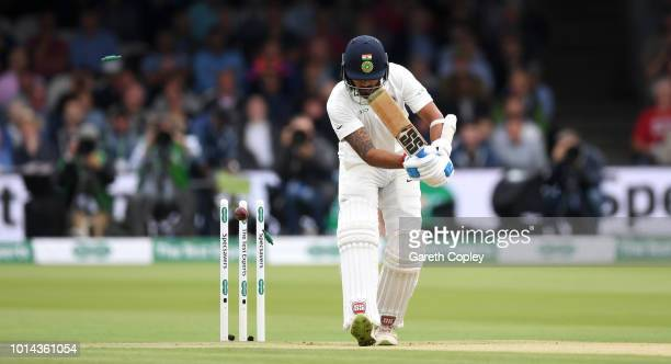 LONDON ENGLAND AUGUST Murali Vijay of India is bowled by James Anderson of England during day two of the 2nd Specsavers Test between England and...