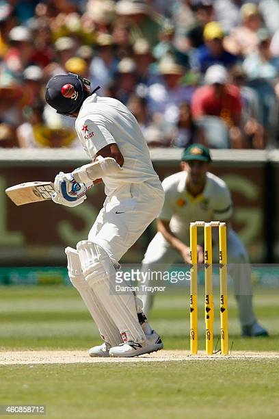 Murali Vijay of India is struck on the helmet by a Mitchell Johnson of Australia bouncer during day three of the Third Test match between Australia...